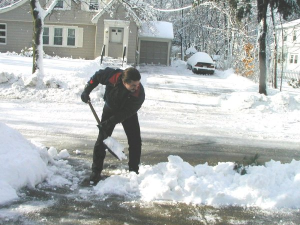 More shoveling.  This is the third time I shoveled out the driveway since the storm started!